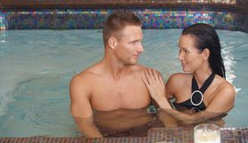 Smiling couple in spa Royalty Free Stock Photo