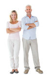 Smiling couple standing with arms crossed Royalty Free Stock Photos