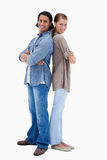 Smiling couple standing back to back Royalty Free Stock Images