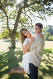 Smiling couple standing and embracing in park Royalty Free Stock Photo