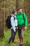 Smiling couple standing in a forest Stock Image