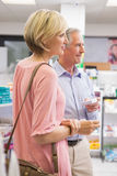 Smiling couple standing with medication Stock Photos