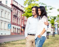 Smiling couple standing outdoors Stock Images