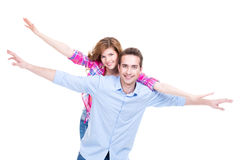 Smiling couple standing with raised. Stock Photography