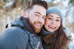 Smiling couple standing in winter park Stock Image