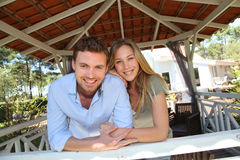 Smiling couple standing in wooden gazebo Stock Images