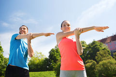 Smiling couple stretching outdoors Stock Image