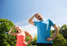 Smiling couple stretching outdoors Stock Photo