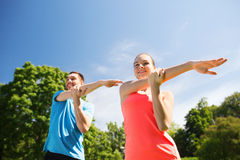 Smiling couple stretching outdoors Stock Photography