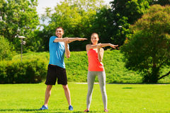 Smiling couple stretching outdoors Royalty Free Stock Photo