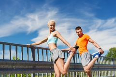 Smiling couple stretching outdoors Royalty Free Stock Image