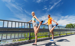 Smiling couple stretching outdoors Royalty Free Stock Photography