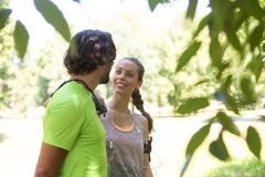 Smiling couple stretching outdoors. In the pablic park Royalty Free Stock Photo