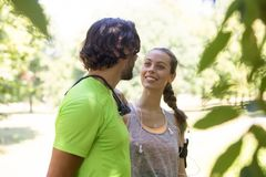 Smiling couple stretching outdoors. In the pablic park Stock Photo