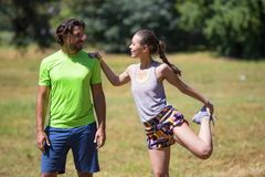 Smiling couple stretching outdoors. In the pablic park Royalty Free Stock Images