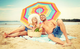 Smiling couple sunbathing on the beach Royalty Free Stock Photos