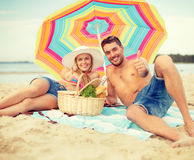 Smiling couple sunbathing on the beach Royalty Free Stock Image