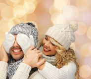 Smiling couple in sweaters and santa helper hats Stock Photography
