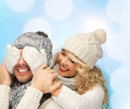 Smiling couple in sweaters and santa helper hats Stock Image