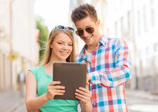 Smiling couple with tablet pc in city Stock Image