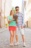 Smiling couple with tablet pc in city Royalty Free Stock Image
