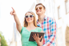 Smiling couple with tablet pc in city Stock Photos