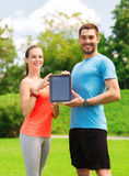 Smiling couple with tablet pc outdoors Stock Photo