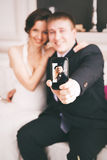 Smiling couple taking photo of themselves Royalty Free Stock Photo