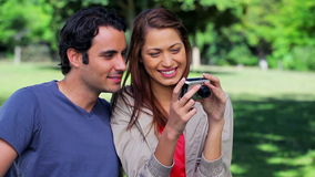 Smiling couple taking a picture of themselves Royalty Free Stock Image