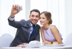 Smiling couple taking self portrait picture stock photography