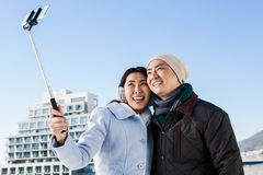 Smiling couple taking selfie Royalty Free Stock Images