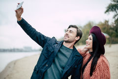 Smiling couple taking selfie on beach Royalty Free Stock Images