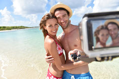 Smiling couple taking selfie on the beach Royalty Free Stock Image
