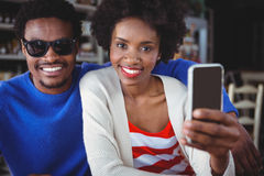 Smiling couple taking a selfie Royalty Free Stock Photos
