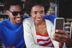 Smiling couple taking a selfie Stock Image