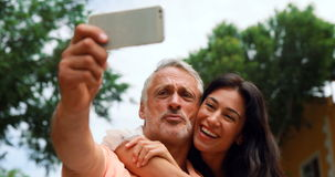 Smiling couple taking selfie stock video