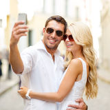 Smiling couple taking selfie with smartphone Stock Images