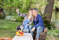 Smiling Couple Taking Selfportrait At Campsite Royalty Free Stock Photo