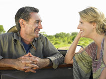 Smiling Couple Talking By Jeep Stock Image