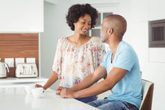 Smiling couple talking. Smiling couple in the kitchen talking Royalty Free Stock Image
