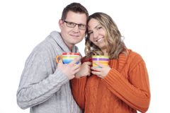 Smiling Couple with tea cups Stock Image