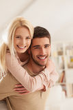 Smiling Couple in Their Living Room Stock Photo