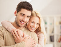 Smiling Couple in Their Living Room Stock Image