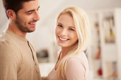 Smiling Couple in Their Living Room Royalty Free Stock Image