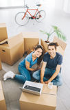Smiling couple in their new house royalty free stock photos