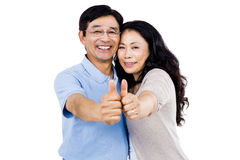 Smiling couple with thumbs up Royalty Free Stock Photography