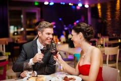 Smiling couple toasting Stock Photo