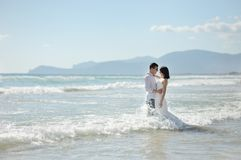 Smiling couple together embracing on the beach, Sperlonga, Italy Stock Images
