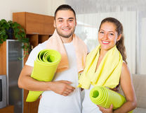 Smiling couple with towels before yoga class Royalty Free Stock Image