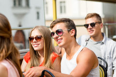 Smiling couple traveling by tour bus. Friendship, travel, vacation, summer and people concept - smiling couple traveling by tour bus Royalty Free Stock Images